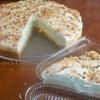 "Raye's Signature 9.5"" Coconut Lime Cheesecake Slice w/ Coconnut Whipped Cream & Toasted Coconuts"